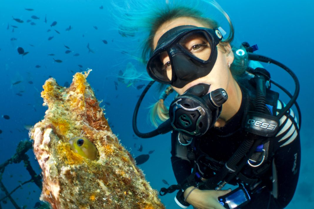 female diver looking into the camera