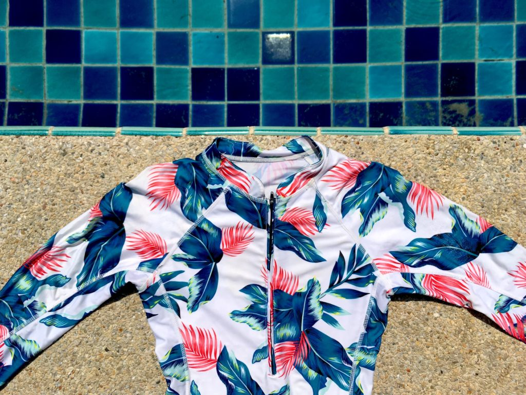 Stylish Rash Guard next to the swimming pool. Do rash guards keep you warm?