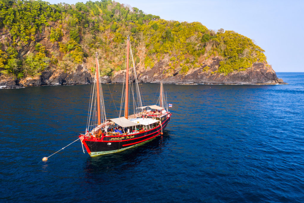 Full shot of the boat when diving The Junk liveaboard in Thailand