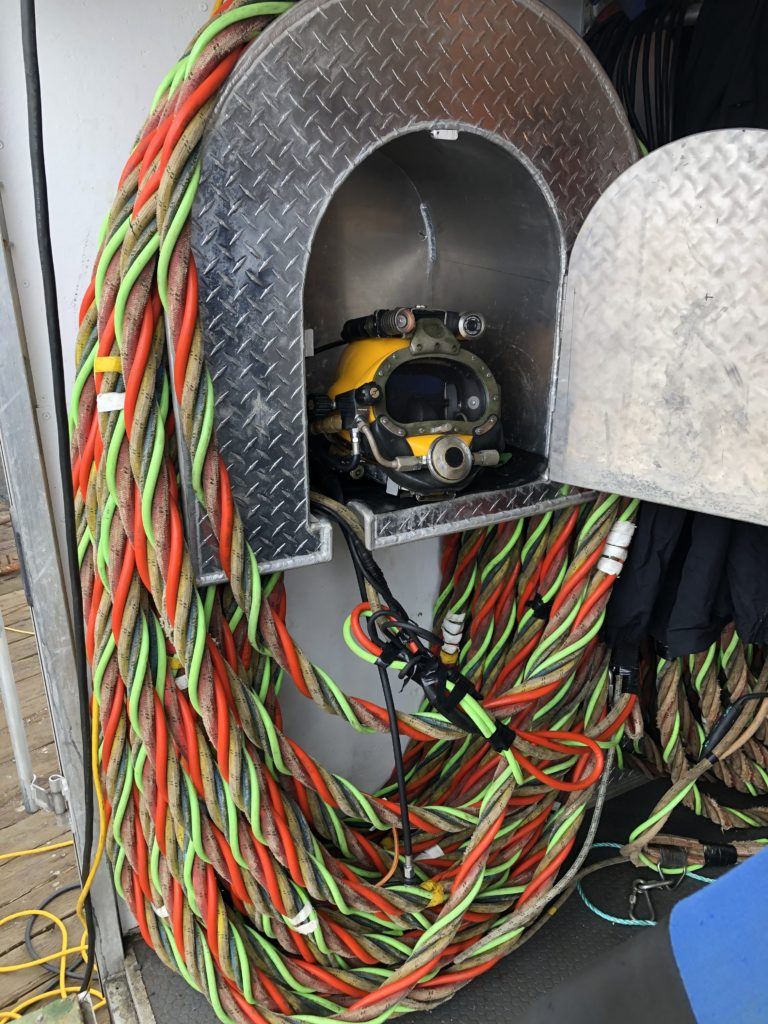 Helmet and umbilical cord used in commercial diving.