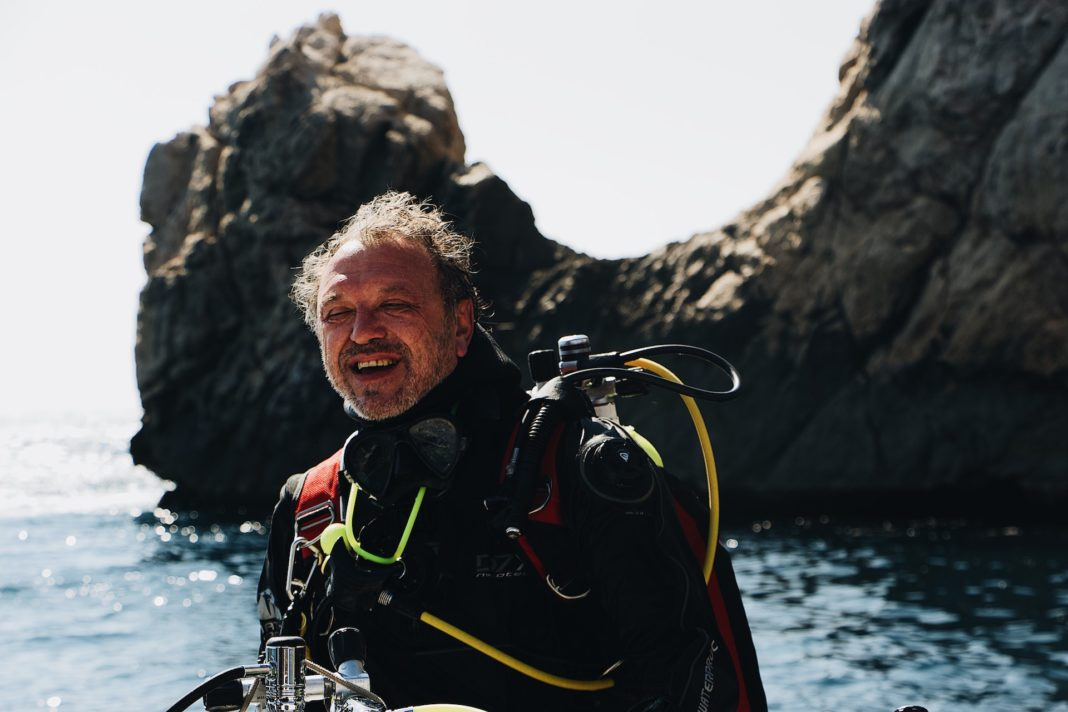 Older man contemplating if there is a maximum age for scuba diving