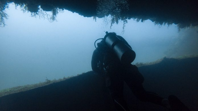 What is the Difference a Cave and a Cavern in scuba diving?