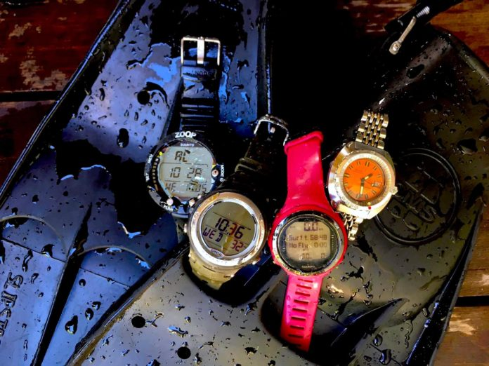 We see four dive watches. Three are digital and one is analogue. What is a dive watch