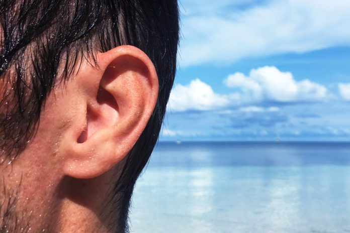 How long can water stay in your ear after scuba diving, snorkeling or swimming?