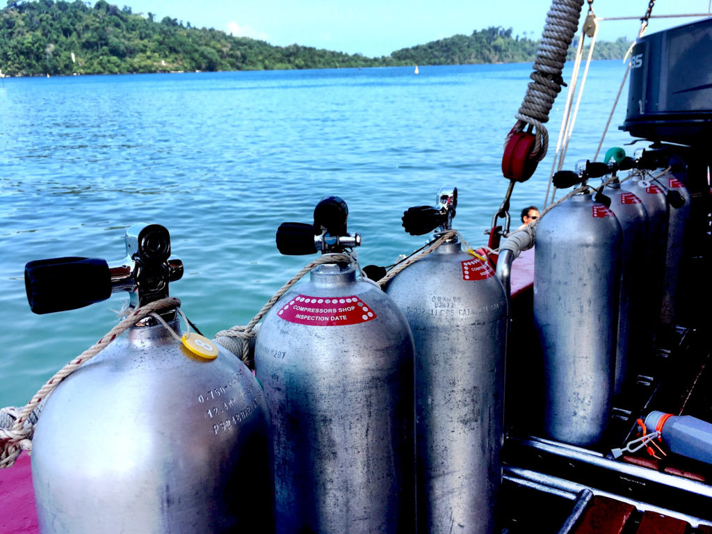 How Long Does A Scuba Tank Last? A few standard 80-cubic-foot scuba cylinders on a dive boat.
