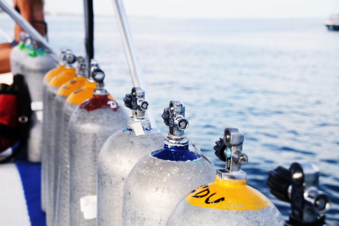 Scuba cylinders on a dive boat. How Many Years Does A Scuba Tank Last?