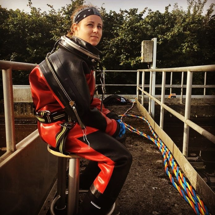 Marie, a female commercial diver in her work suit