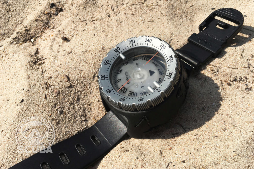 How To Navigate with a Compass Underwater when you are scuba diving. A photo of a standard diving compass.