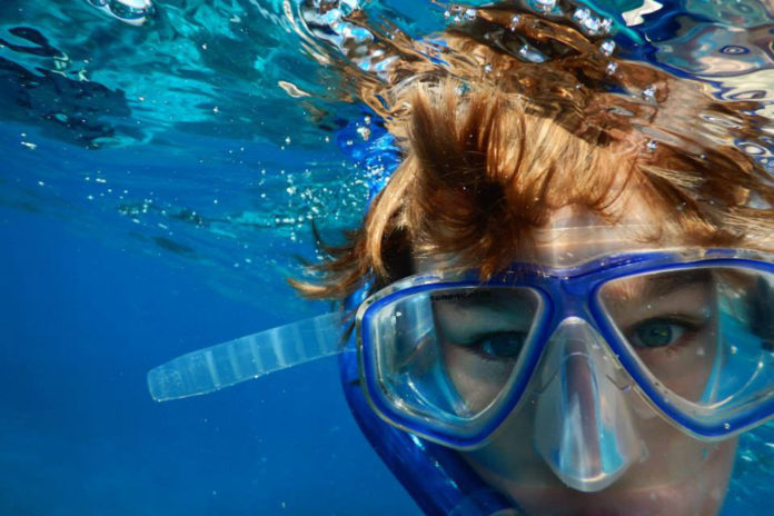 Boy enjoying his snorkel trip. What Do You Need To Go Snorkeling?