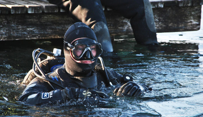 Diver getting ready on the surface. What Happens When You Hold Your Breath While Scuba Diving?