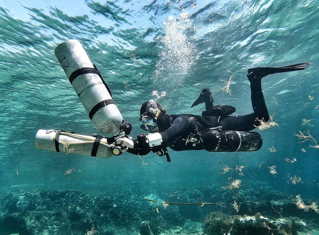 Female tech diver Miranda Bowman with her sidemount configuration