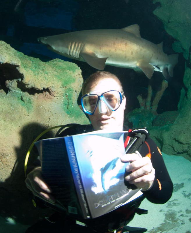 Mark Caney reading Dolphin Way underwater
