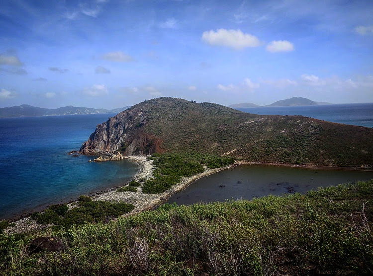 the British Virgin Islands: salt pond on the right, ocean on the left.