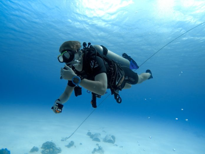 A scuba diver underwater. Learning the no mask breathing skill is important.